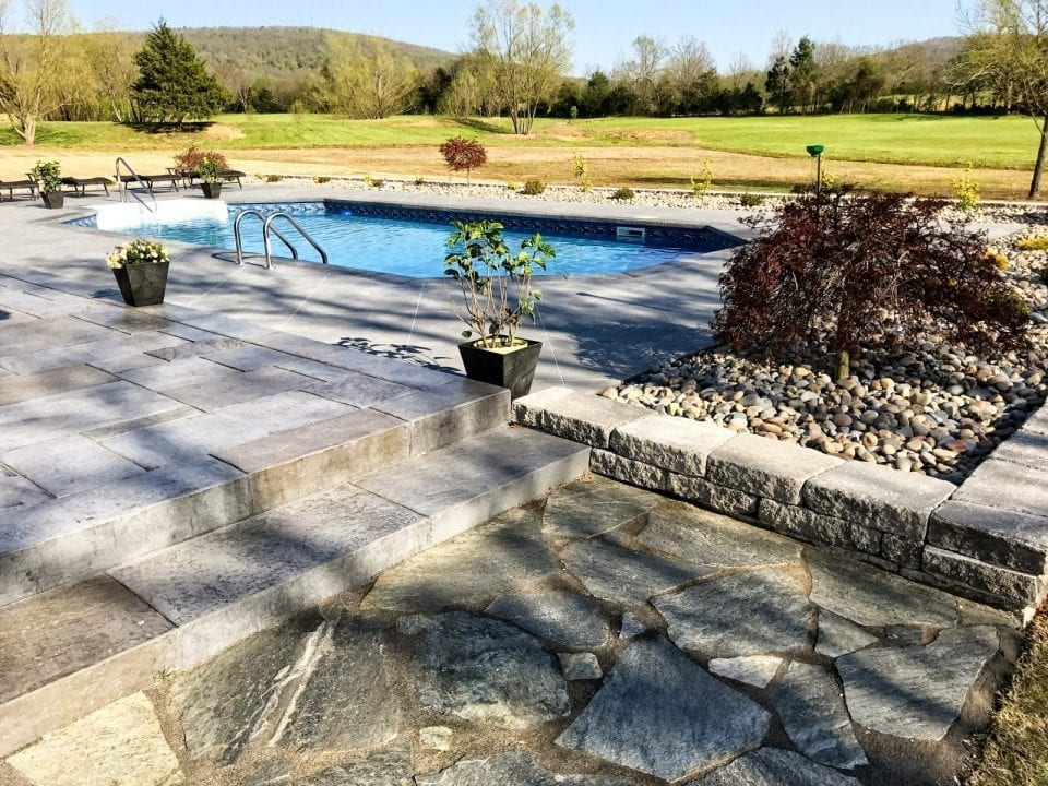 Retainer Wall Flagstone Patio Landscape Installation In