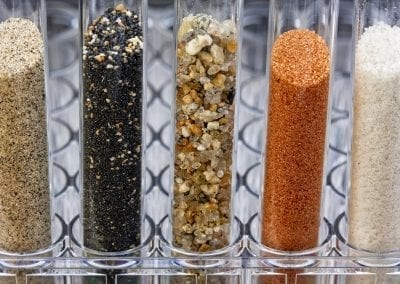 sand samples in laboratory testing tubes