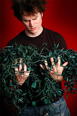 Man worried about untangling the Christmas lights.
