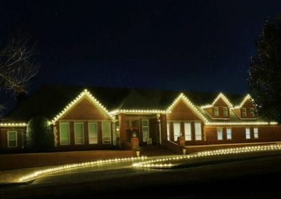 A home with Christmas tree lights installed in Fayetteville.