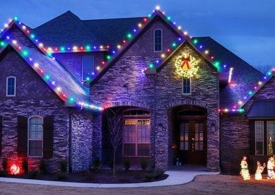 A home with Christmas tree lights installed in Fayetteville