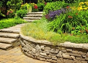 Natural stone stairs and retaining wall with garden.